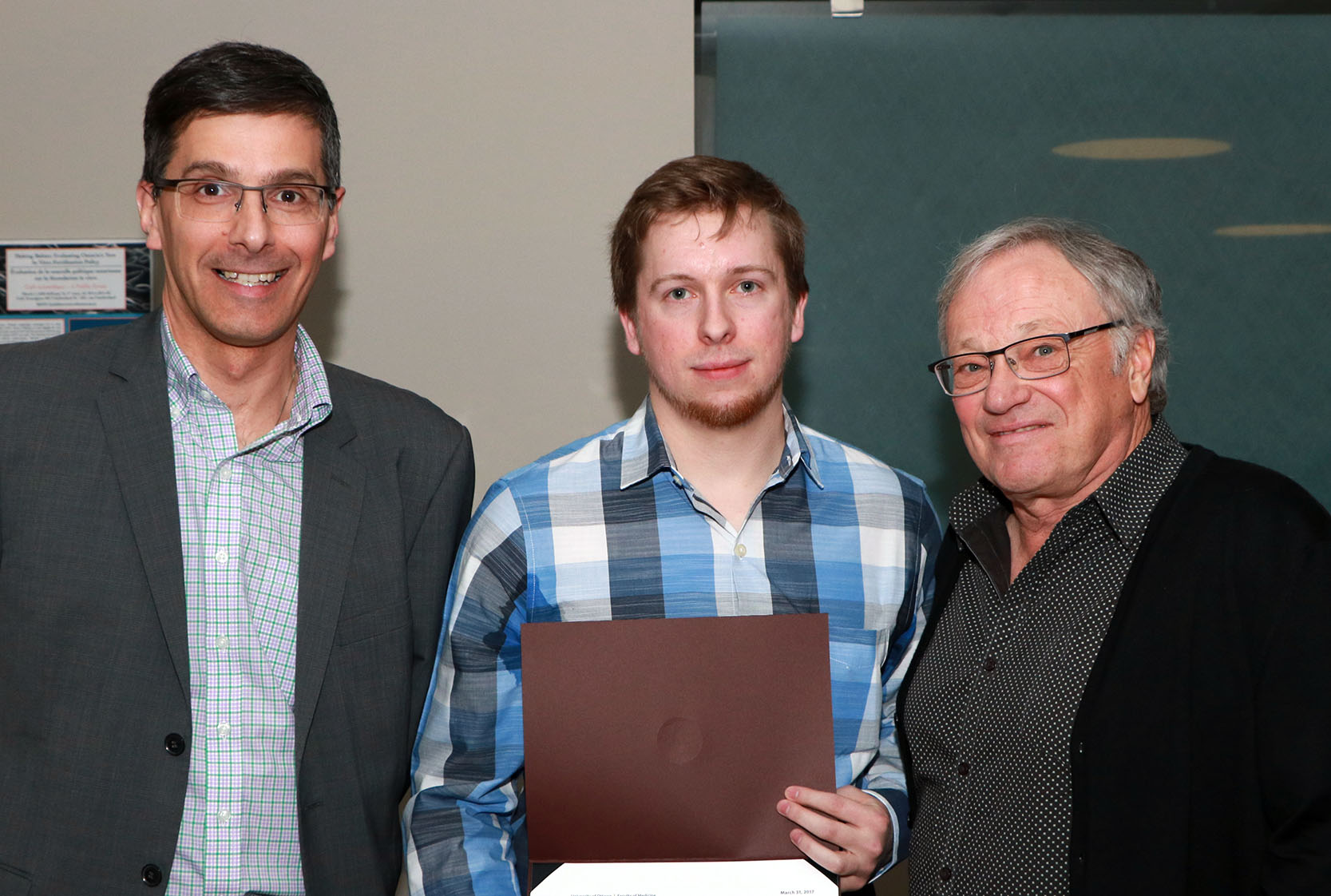Dr. Figeys, Matt Michalicka and Dr. Korneluk