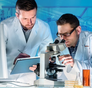 Scientists working together in a lab
