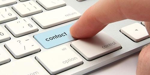 Bouton de contact sur le clavier d'un portable