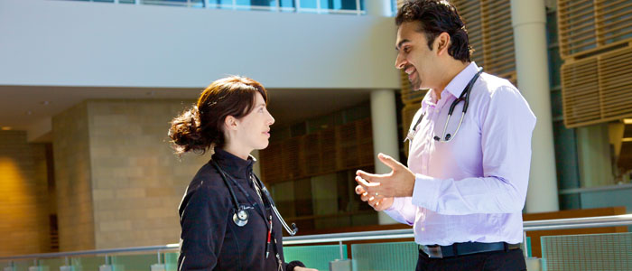 Two emergency Physicians talking in the foyer of Hospital
