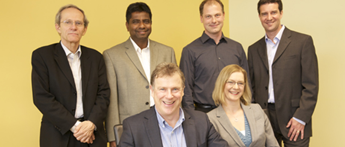 Group photo of Dr. Ian Stiell, Dr. Jeff Perry, Dr. Christian Vaillancourt, Dr. Lisa Calder, Dr. George Wells and Dr. Venkatesh Thiruganasambandamoorthy