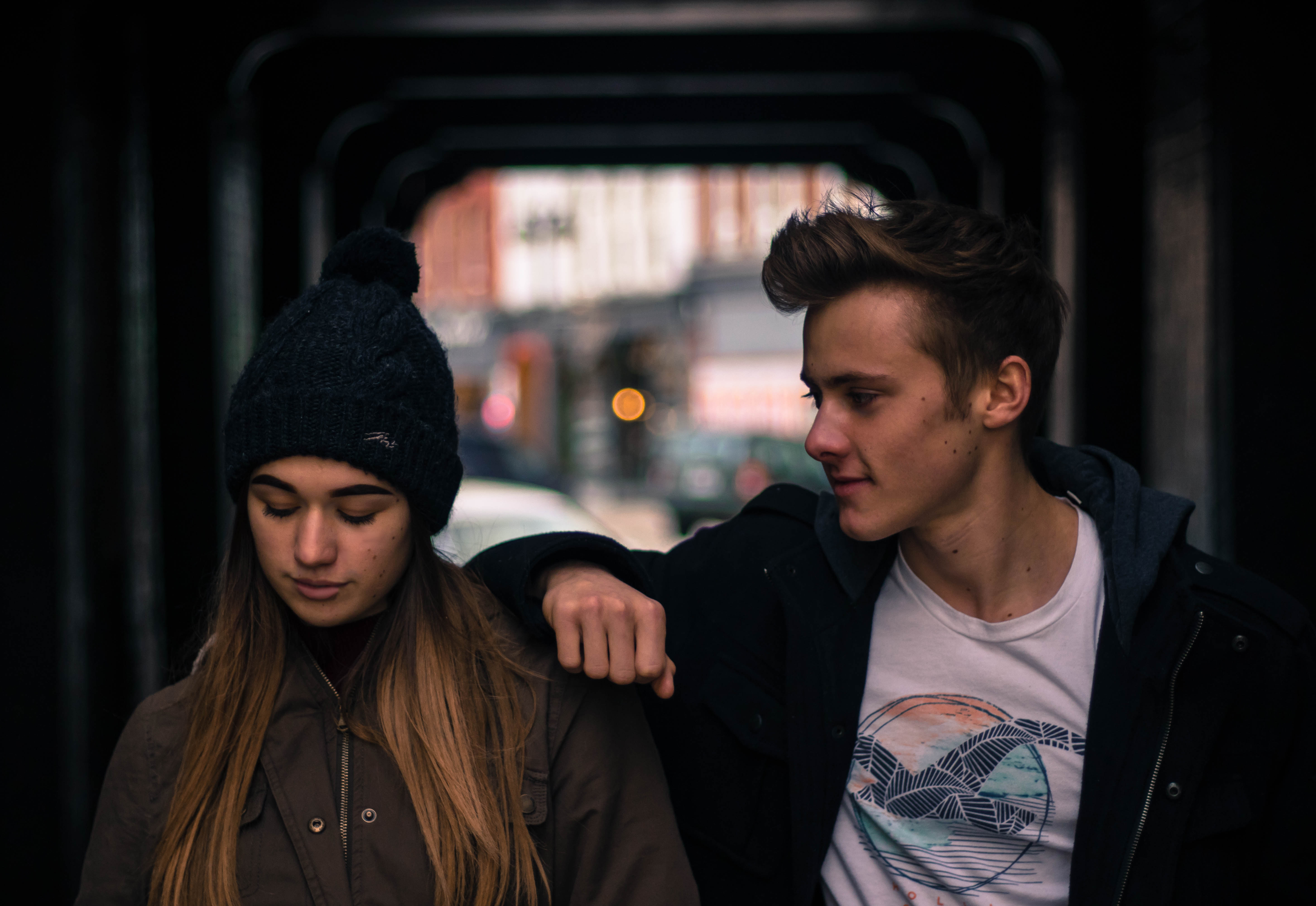 a boy looking at a girl