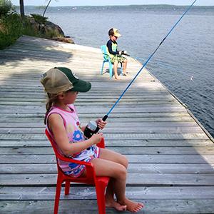 My grandchildren fishing at our cottage on Charleston Lake
