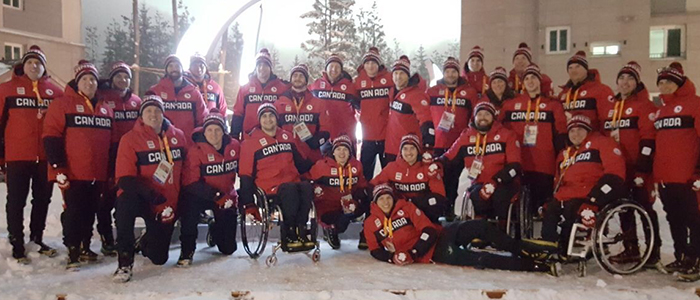 Dr. Lindsay Bradley and the 2018 Canadian Paralympic Sledge Hockey Team