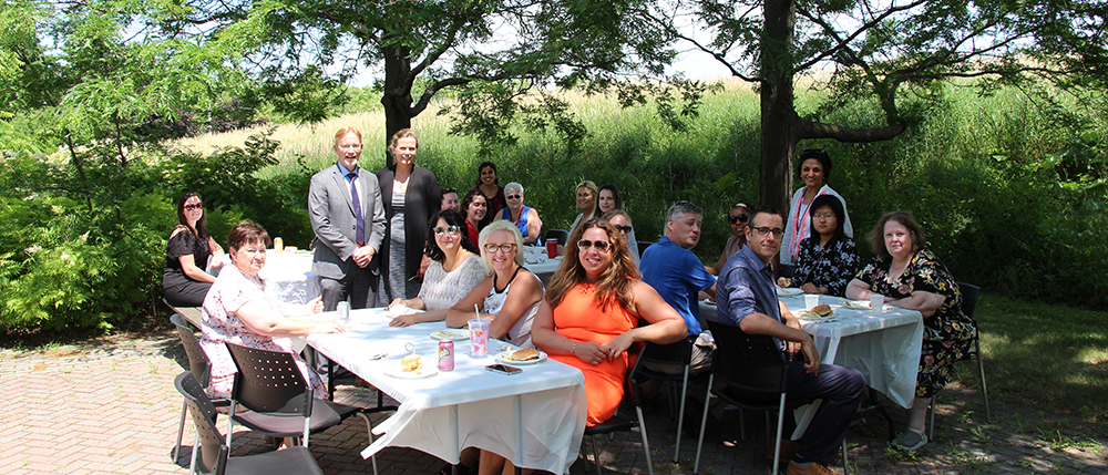 Dr. Clare Liddy, DFM Staff and Dr. Liddy's Research Team at a BBQ with Dr. Bernard Jasmin.