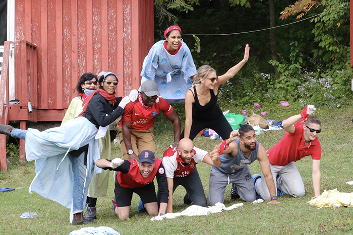 Family medicine campers create a human pyramid