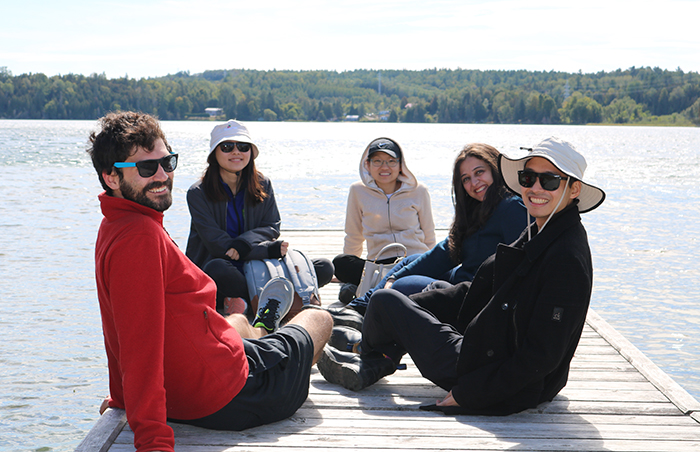 Family medicine residents on the dock at St. Brigid's Camp