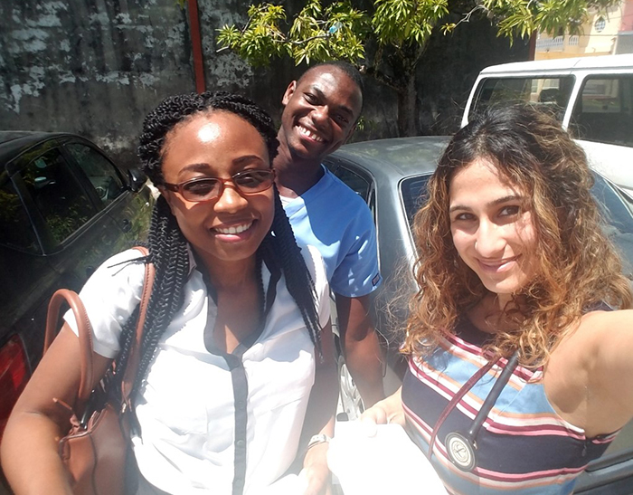 Guyanese Family Medicine residents Dr. Tamica Daniels-Williamson (left) and Dr. Ronald Robinson with Beauty Sandhu.