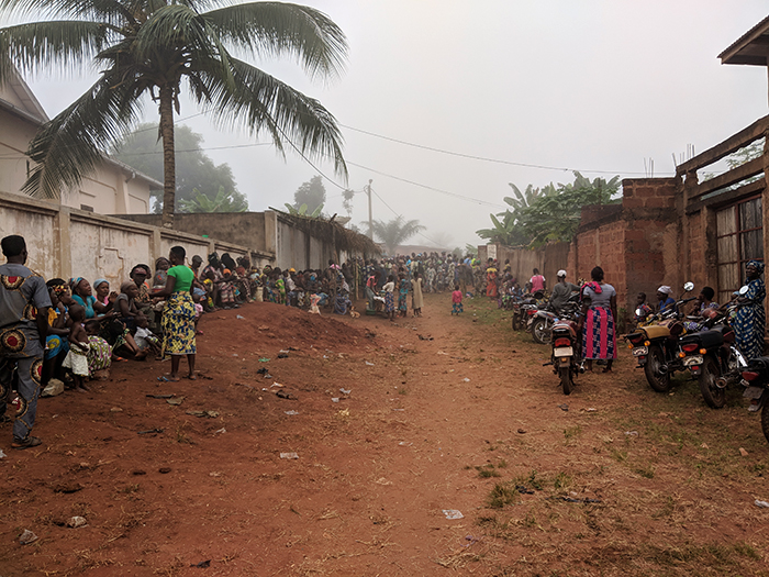 The mass of people awaiting our rural primary care clinic in Benin; the line-ups would sometimes start before dawn.