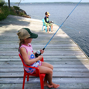 My grandchildren fishing at our cottage on Charleston Lake
