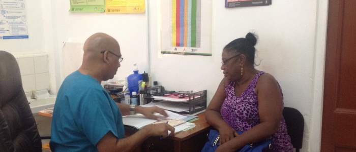 Dr. Kampta Prashad, Class of 2016 Family Medicine resident, meets with a patient in Guyana.