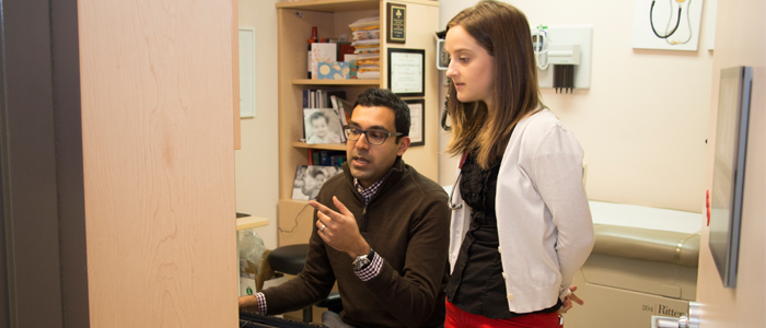 A DFM preceptor and family medicine resident discuss a patient's file in a clinical setting at the Primrose teaching unit.