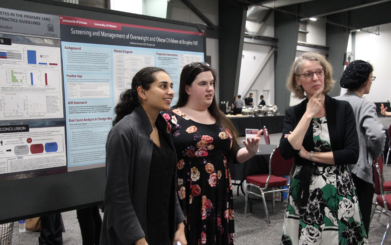 R1 residents nominated for the top QI award displayed their Quality Improvement projects at a coffee break poster session at RIO day, an annual event for the Department of Family Medicine that celebrates the research achievements of residents