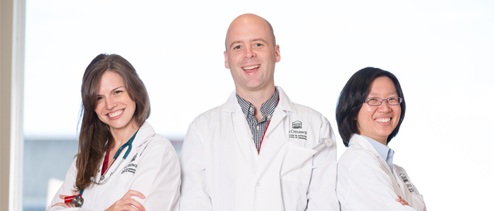 Three smiling medical students prepare to enter the medical profession in their uOttawa white coats.