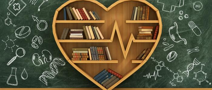 Bibliothèque en cœur symbolisant les ressources proposées sur notre site de formation médicale continue