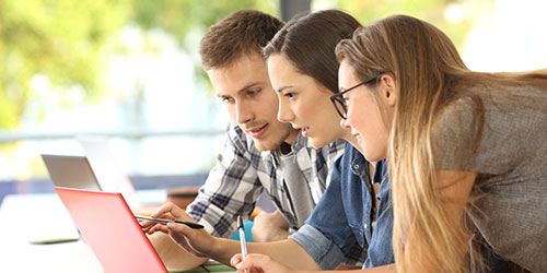Three students studying together on line