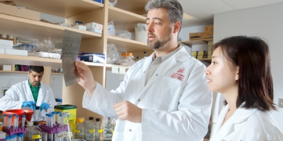 A supervisor and his student in a laboratory