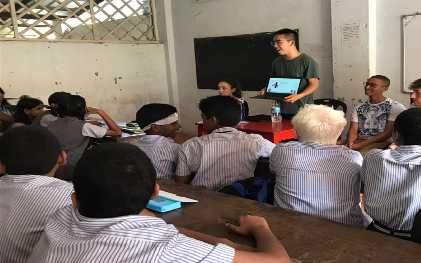 A medical student at healthy eating presentation at a local school in India