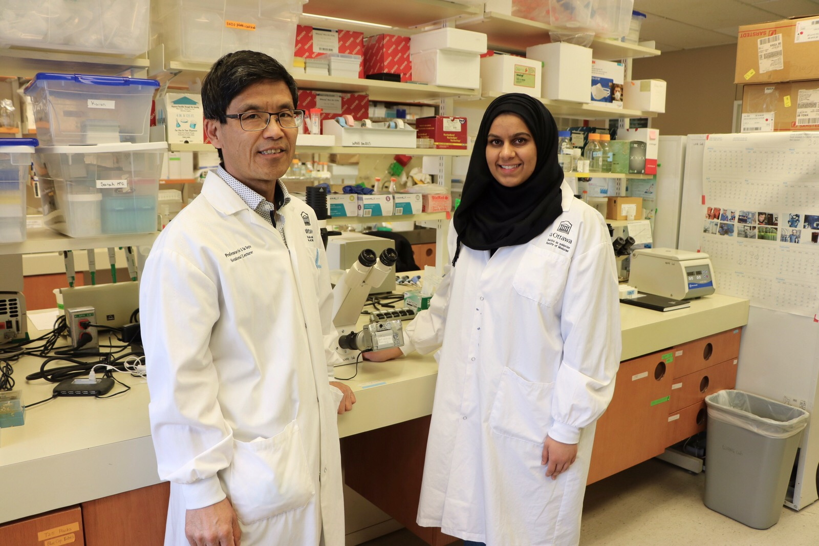 Picture of Sara Asif and Lisheng Wang in lab