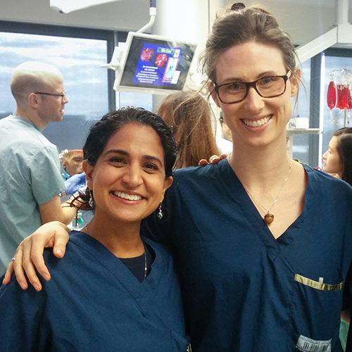 two residents in surgical scrubs