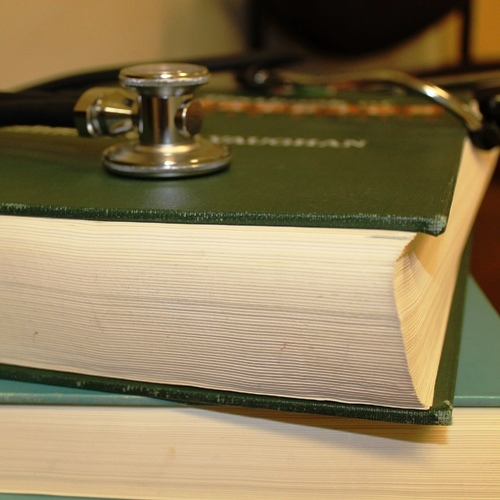 Green book with stethoscope