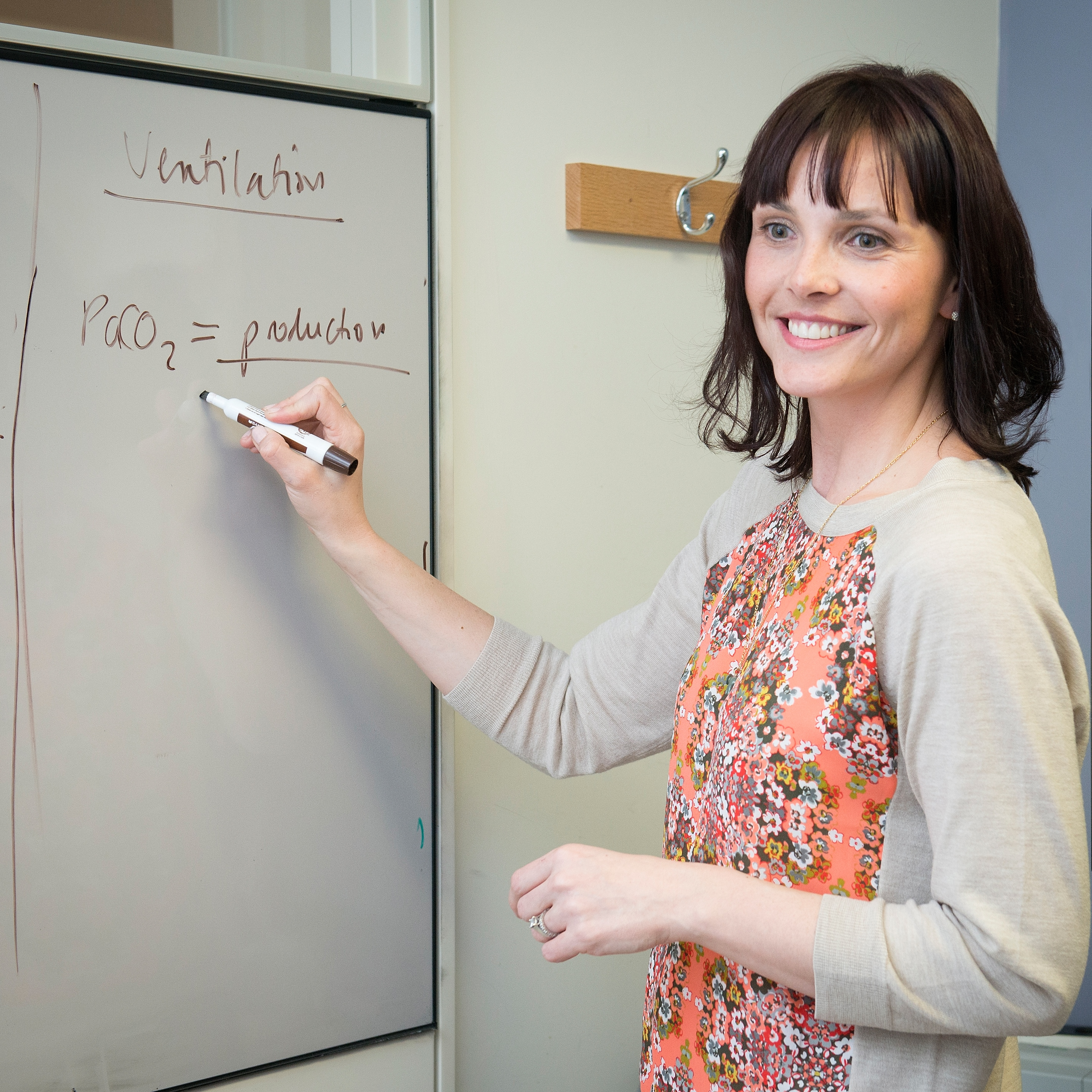 Physician teaching in clinic using a whiteboard