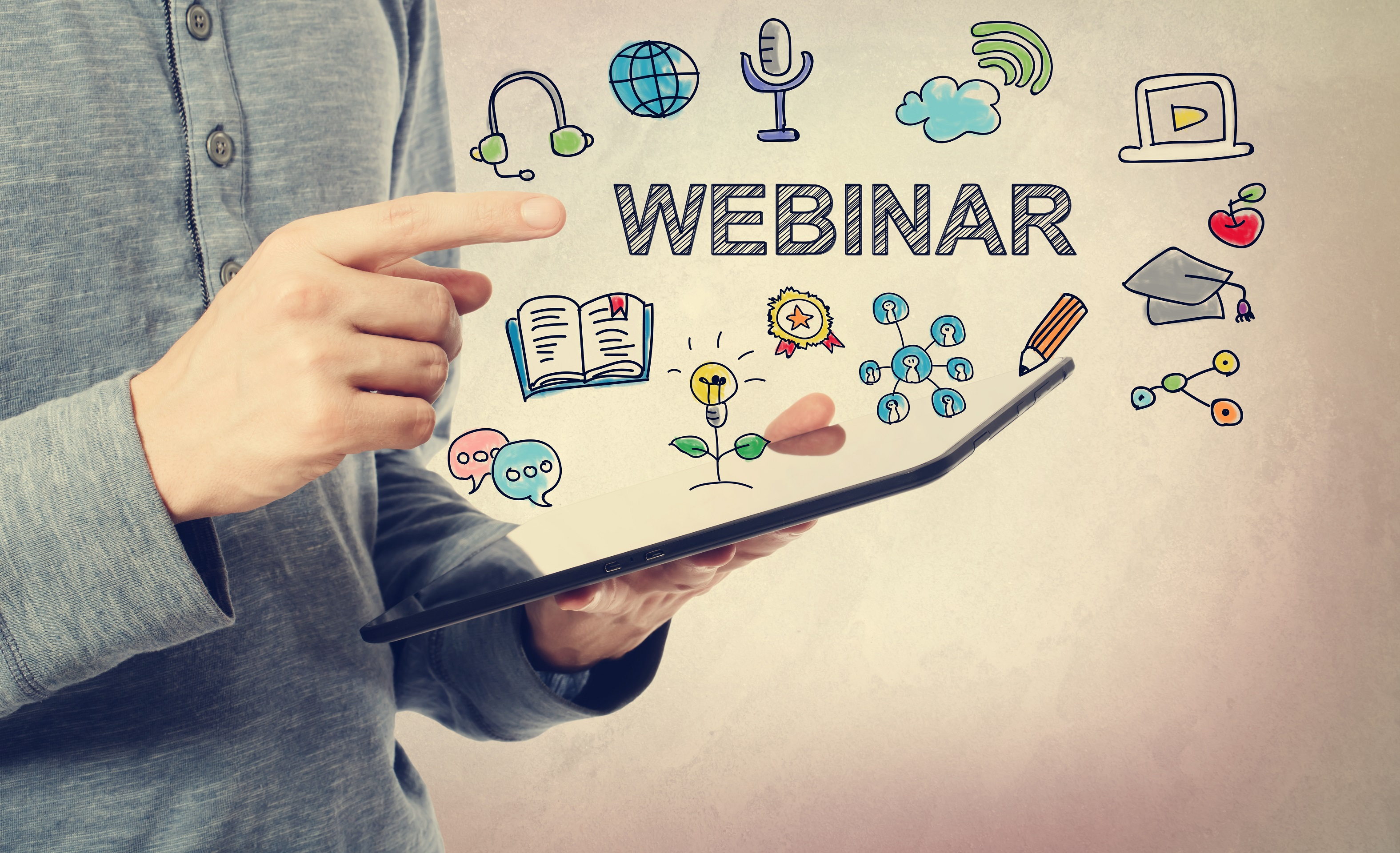 Person holding tablet surrounded by webinar icons