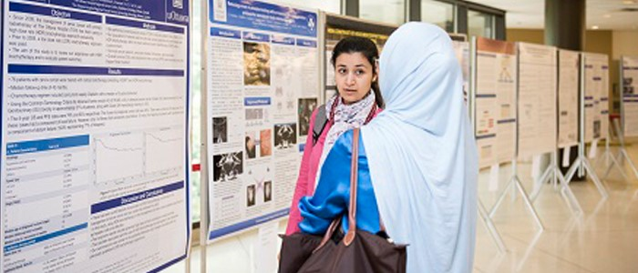 student explains research day project