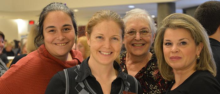 Quatre membres du personnel de soutien de la Faculté de médecine.
