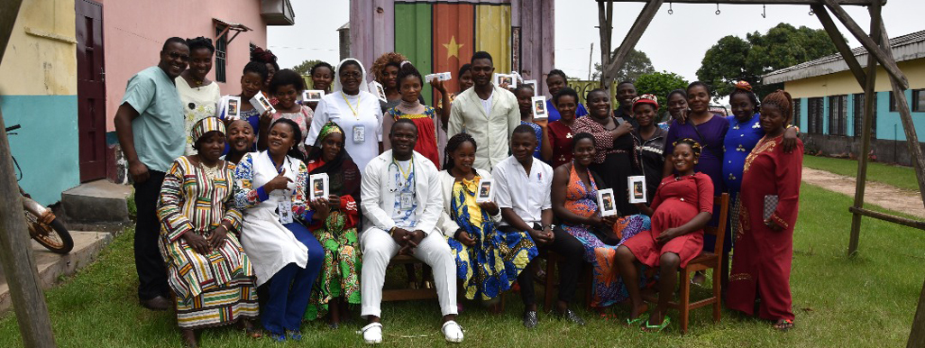 Health providers and health administrators in the Bali district of Cameroon posing with expectant mothers
