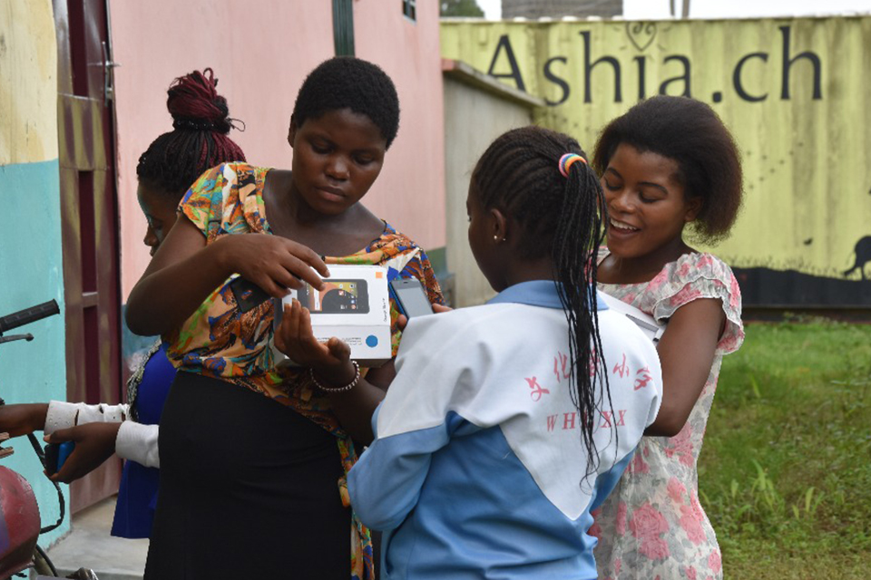 three women looking at mobile phones