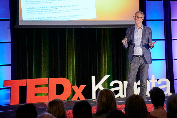 Dr. Phil Wells on stage at TedXKanata