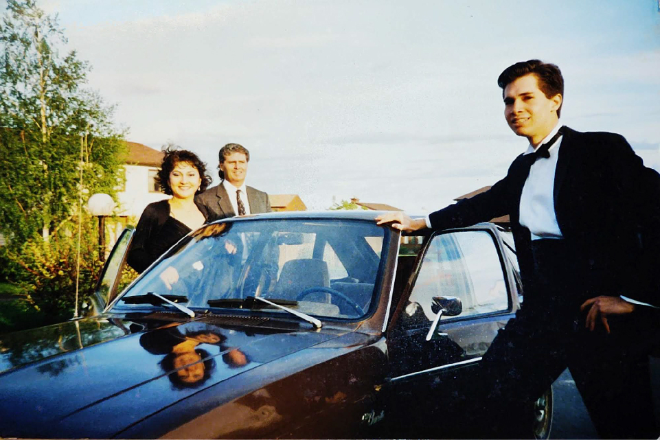 Robert Harris in a tux with his parents and a car
