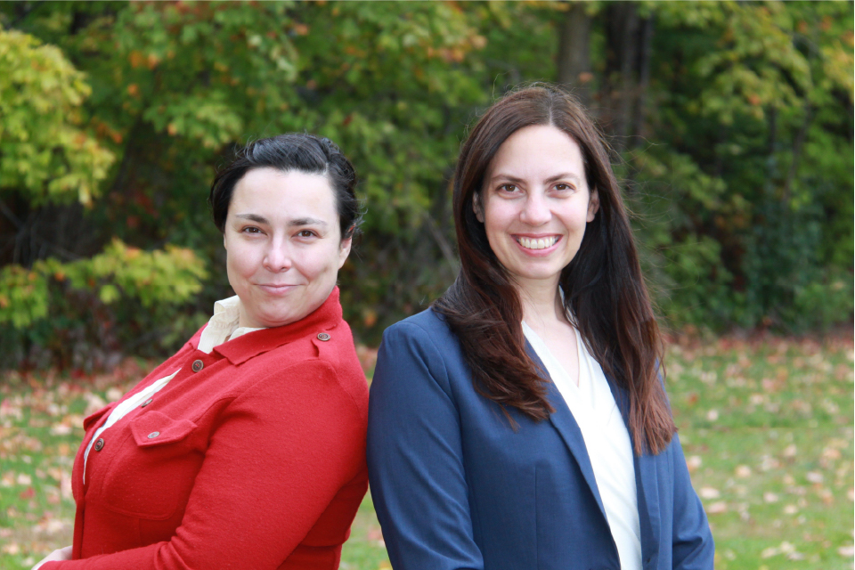 Katerina Nikolitch and Jennifer Phillips stand back to back