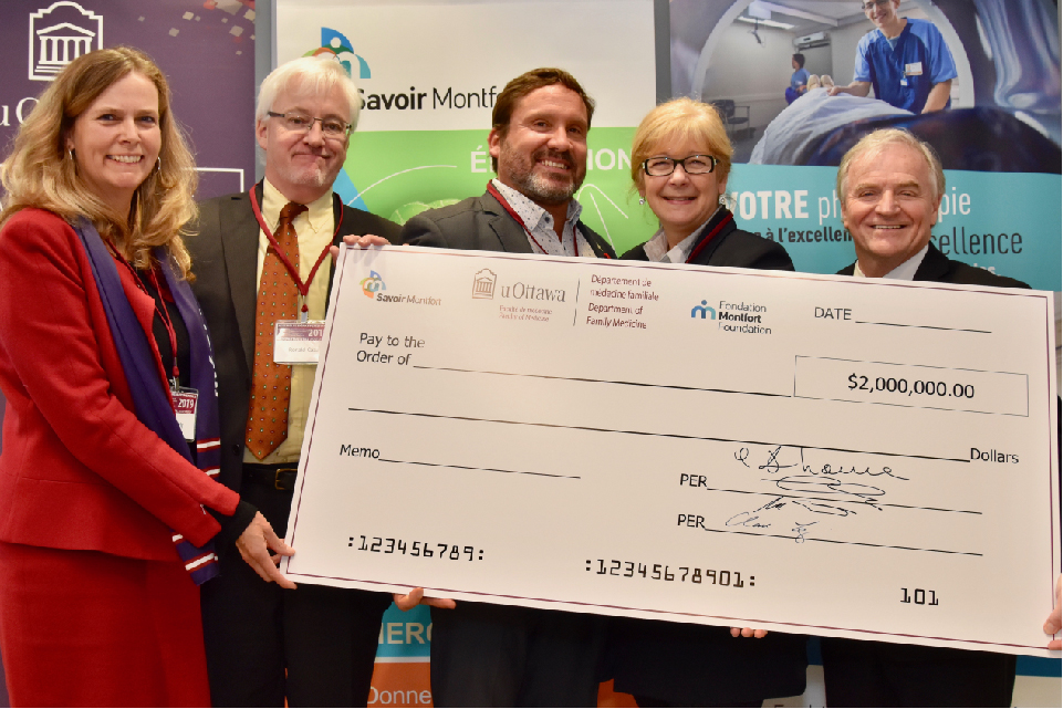 (left to right) Dr. Clare Liddy, Ronald Caza,  Marc Villeneuve, Céline Monette and Dr. Denis Prud'homme hold an enormous cheque for $2 million