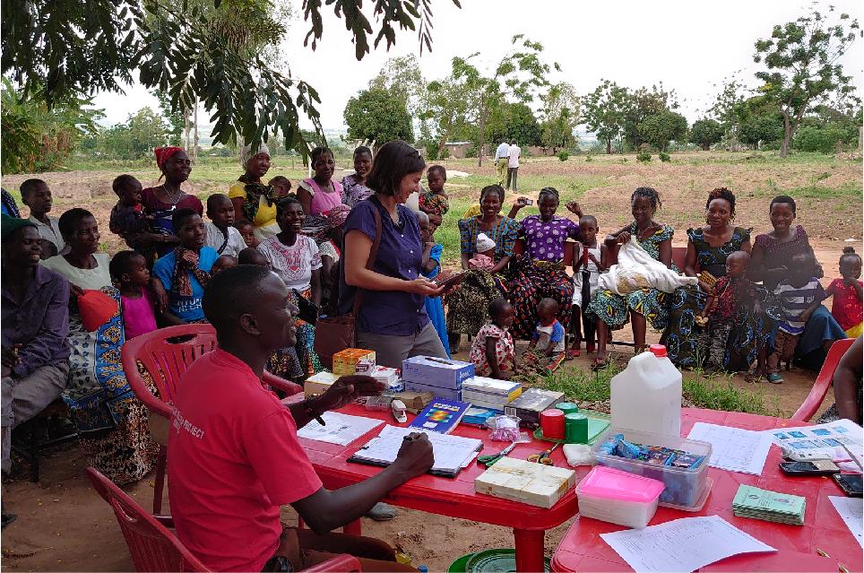 Dr. Manisha Kulkarni stands in a Tanzanian village.