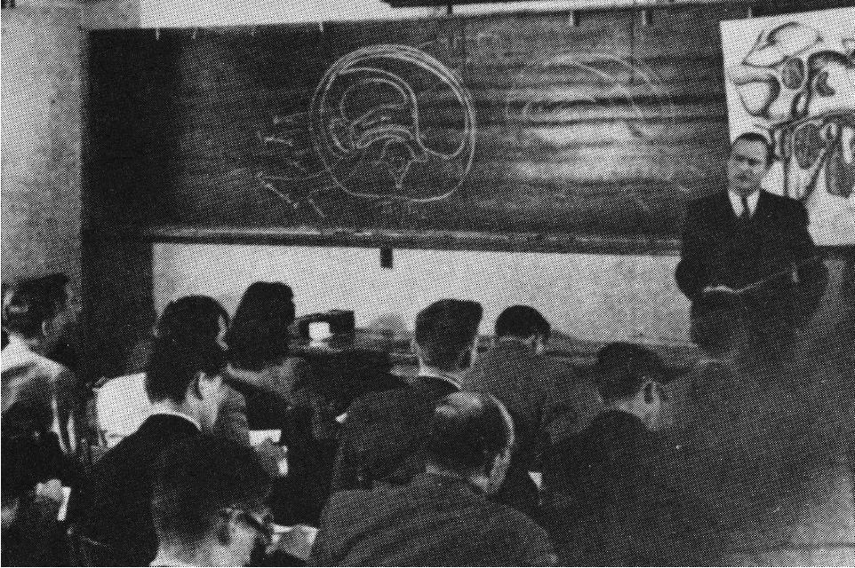 Dr. Joseph Auer teaches an anatomy class in 1948