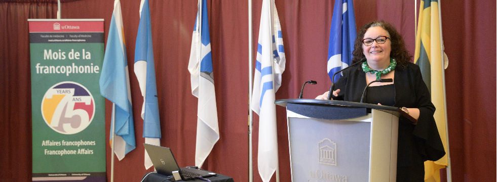 Dr. Manon Denis Leblanc and flags