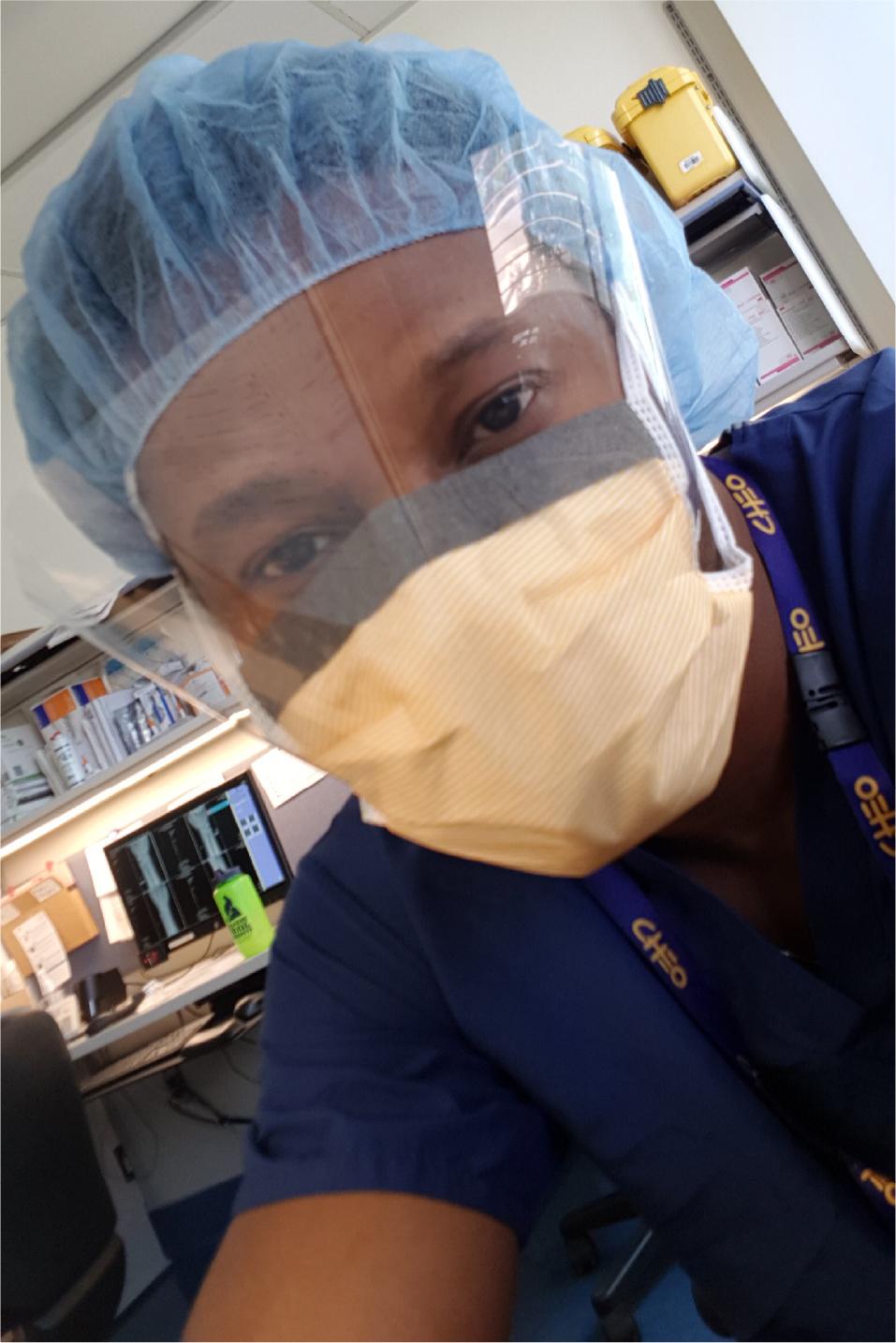 Dr. Karry Felix in surgeon's garb