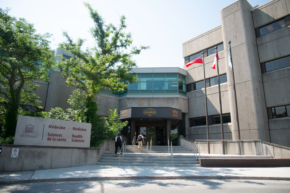A view of the entrance of Roger Guindon hall.