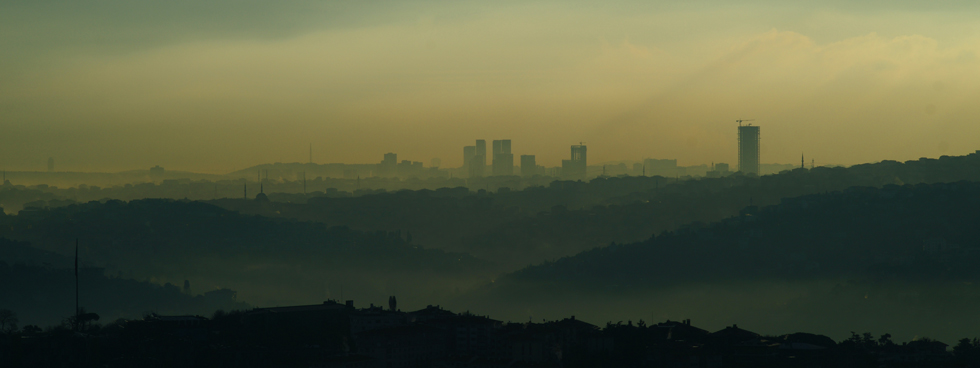 A cloud of pollution covering a city.