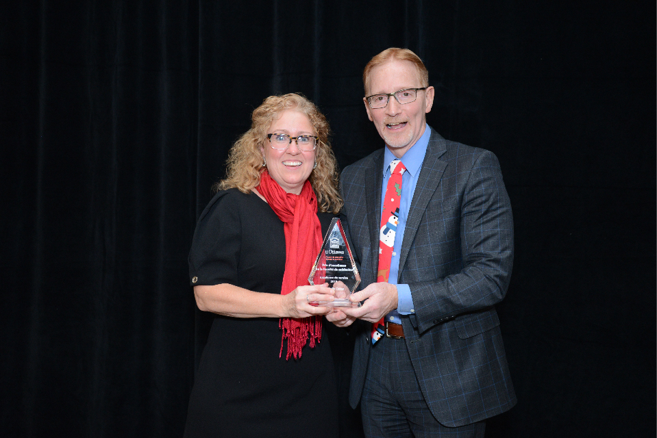 Dr. Jasmin, Dean of the Faculty of Medicine, with Danielle Caron, 2019 Service Excellence award winner.