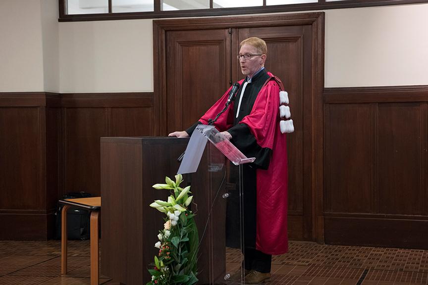 Dr. Bernard Jasmin standing behind a podium