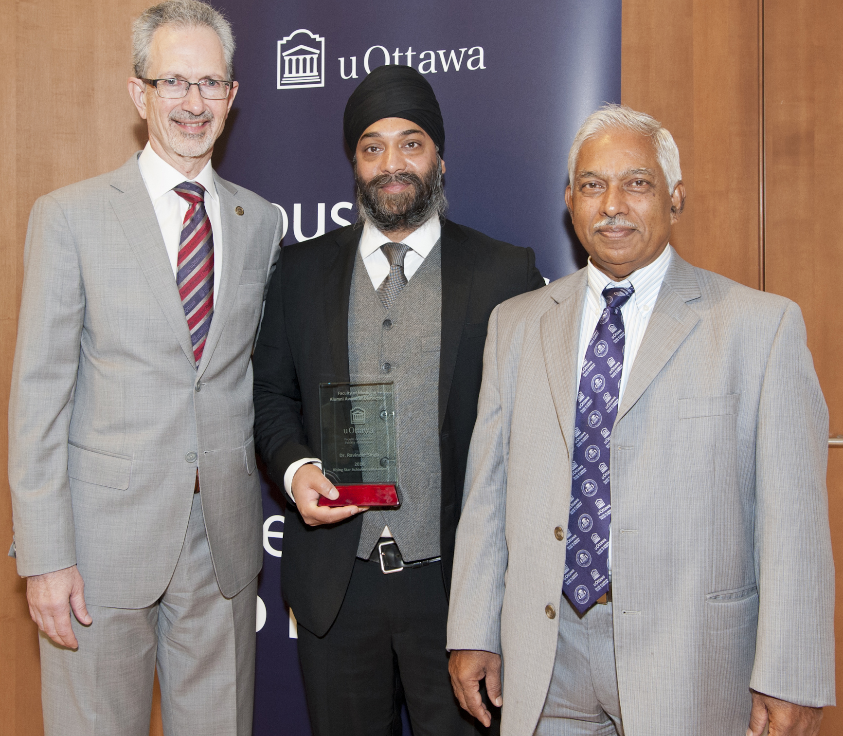 A photo of Dr. Ravinder Singh receiving the Rising Star Achievement award from Dr. Jacques Bradwejn