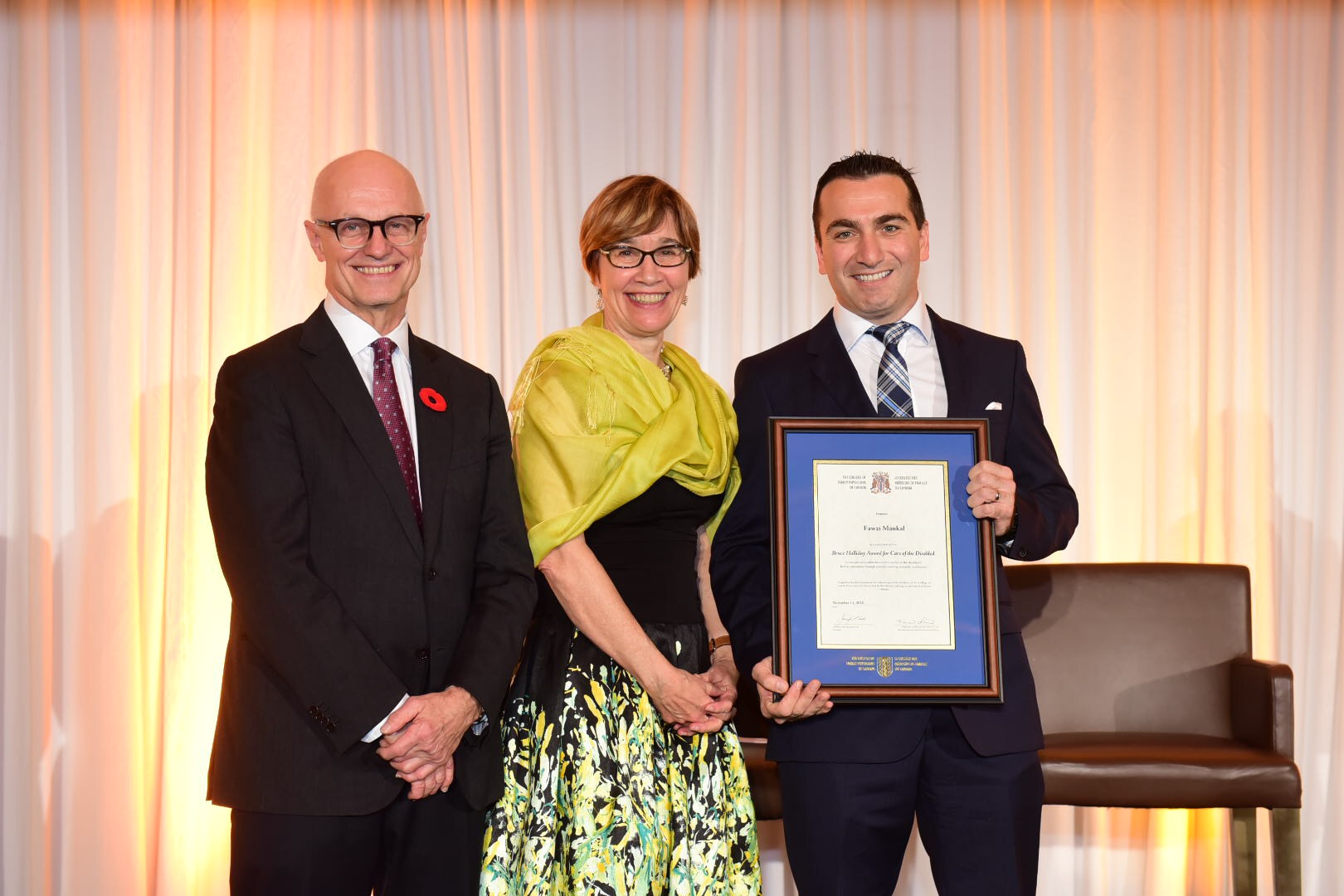 Photo of Dr. Fawzi Mankal receiving an award at the November 11 gala.