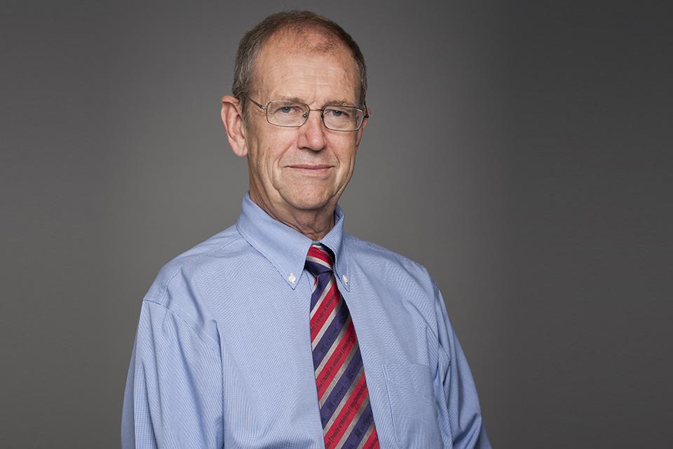 Headshot of Dr. Tugwell