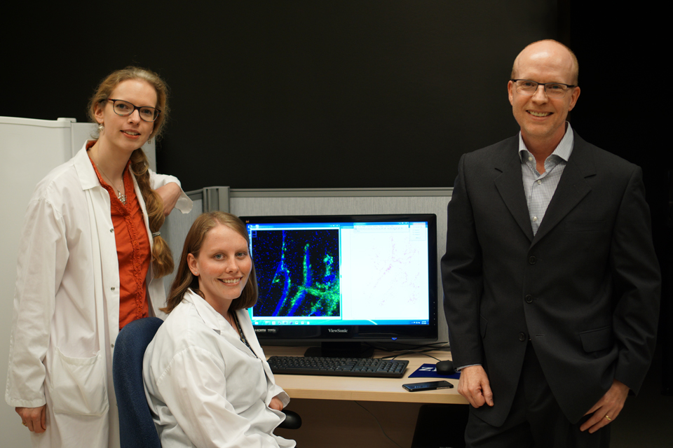Photo of Dr. Chloë van Oostende-Triplet, Skye Green and Dr. John Copeland.