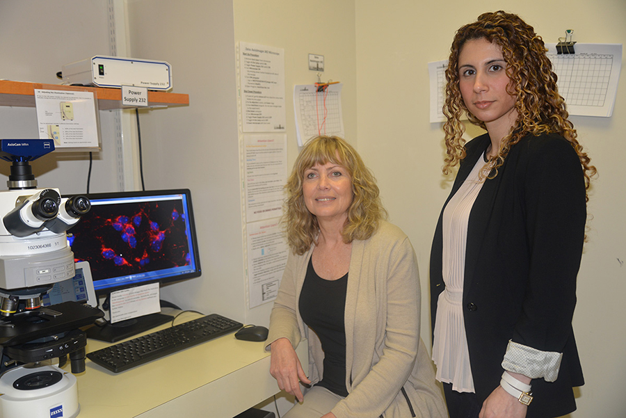 Drs. Ruth Slack and Mireille Kacho in their lab