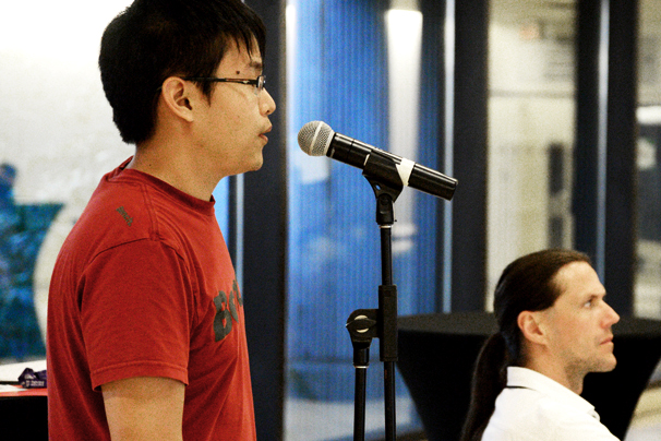 A student speaking into a microphone.