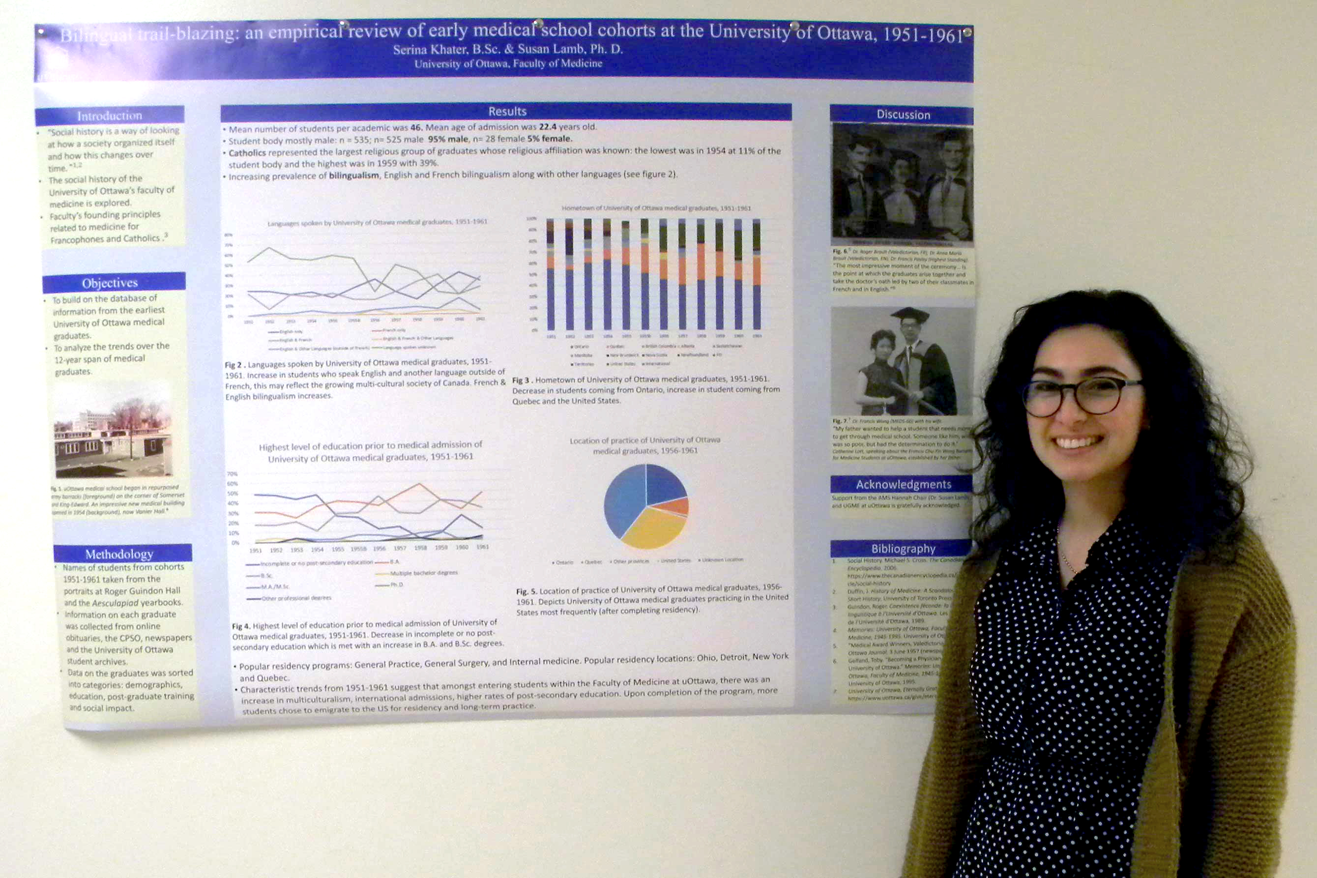 Photo of Serina Khater standing in front of her poster.